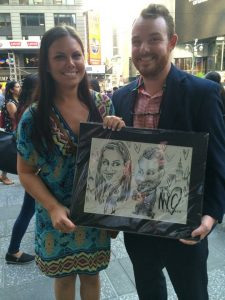 Cody and Sarah with the caricature that prompted the proposal.